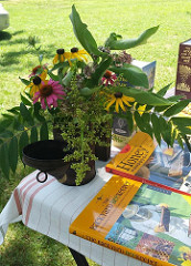 photo from beekeeping presentation including flowers and books about bees