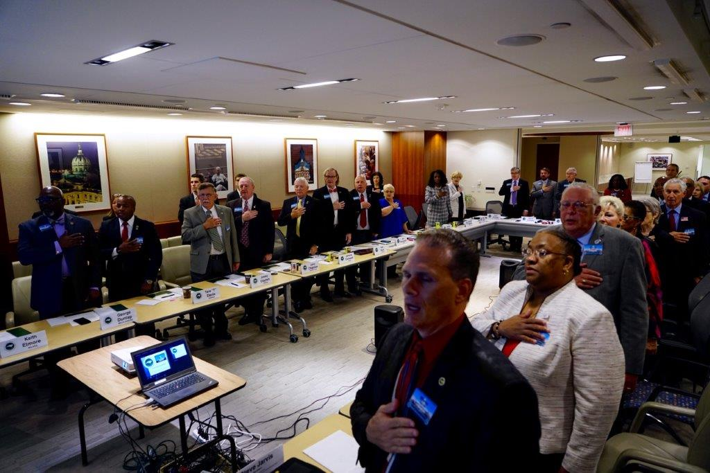 NCACC Board of Directors reciting the Pledge of Allegiance during the opening of their meeting at the National Association of Counties (NACo) Headquarters